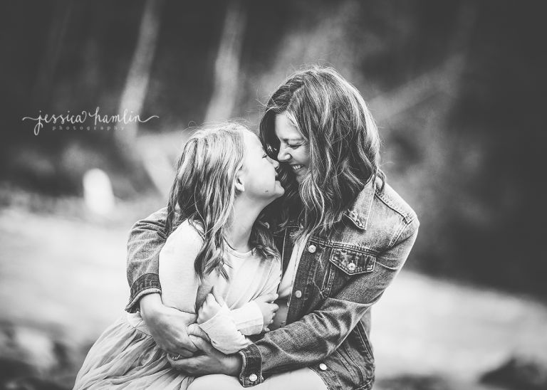 black white image mom daughter